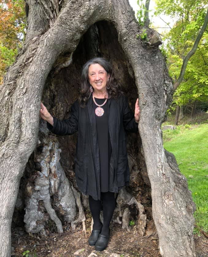 Photo of Karen Pillsworth In a Tree Trunk